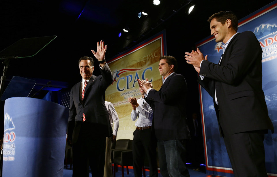 Republican presidential candidate, former Massachusetts Gov. Mitt Romney speaks at a Colorado Conservative Political Action Committee (CPAC) meeting in Denver, Thursday, Oct. 4, 2012. At rear are sons Craig, Tagg, and Josh Romney. (AP Photo/Charles Dharapak)