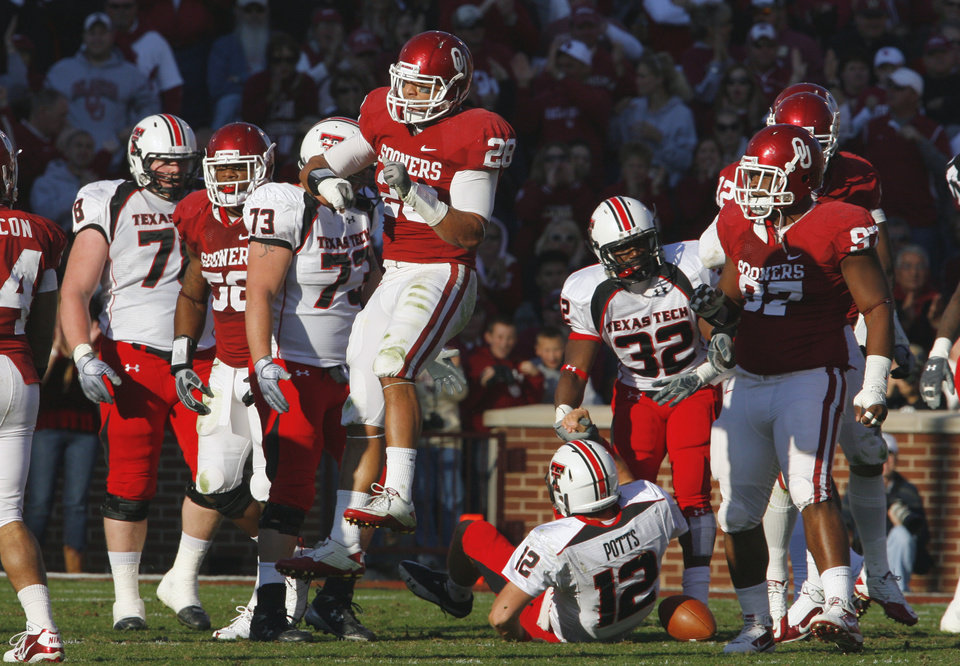 Photo - Travis Lewis (28) celebrates after the defense sacks quarterback Taylor Potts (12) during the first half of the college football game between the University of Oklahoma Sooners (OU) and the Texas Tech Red Raiders (TTU) at the Gaylord Family Memorial Stadium on Saturday, Nov. 13, 2010, in Norman, Okla.  Photo by Steve Sisney, The Oklahoman