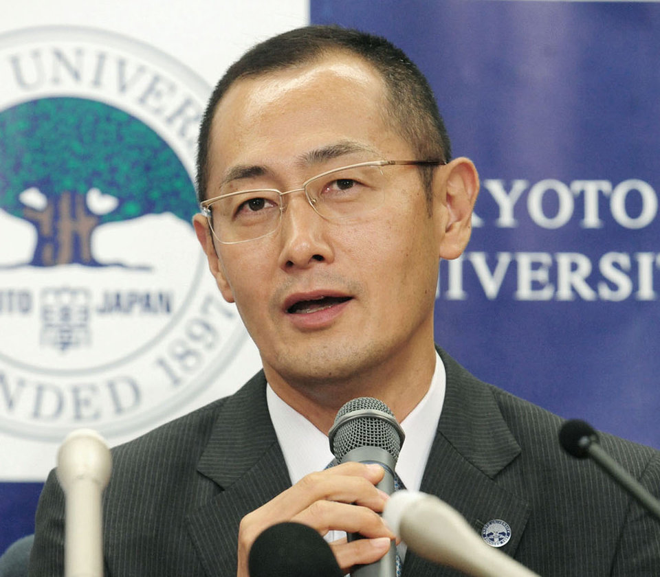 Kyoto University Professor Shinya Yamanaka speaks during a news conference at Kyoto University in Kyoto, western Japan, Monday, Oct. 8, 2012, after learning that he and British researcher John Gurdon won this year's Nobel Prize in physiology or medicine. The prize committee at Stockholm's Karolinska Institute said the two won the prize for discovering that mature, specialized cells of the body can be reprogrammed into stem cells � a discovery that scientists hope to turn into new treatments. (AP Photo/Kyodo News) JAPAN OUT, MANDATORY CREDIT, NO LICENSING IN CHINA, FRANCE, HONG KONG, JAPAN AND SOUTH KOREA