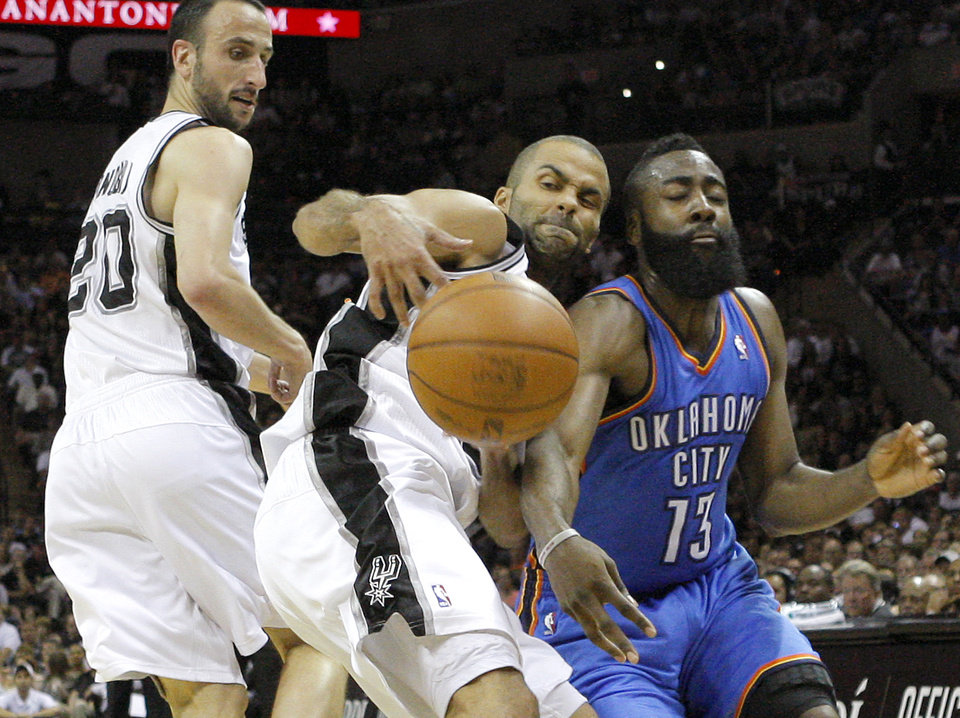 Oklahoma City's James Harden (13) goes for the ball beside San Antonio's Tony Parker (9) as Manu Ginobili (20) watches during Game 1 of the Western Conference Finals between the Oklahoma City Thunder and the San Antonio Spurs in the NBA playoffs at the AT&T Center in San Antonio, Texas, Sunday, May 27, 2012. Photo by Bryan Terry, The Oklahoman