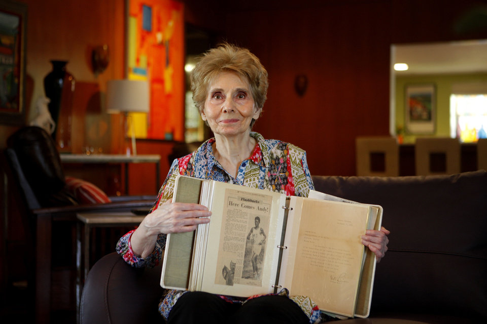 Photo - Norma Roupe holds a scrapbook with clippings and letters about her father Andy Payne in her Oklahoma City home, Friday, May 25, 2012. Photo by Bryan Terry, The Oklahoman  BRYAN TERRY - THE OKLAHOMAN