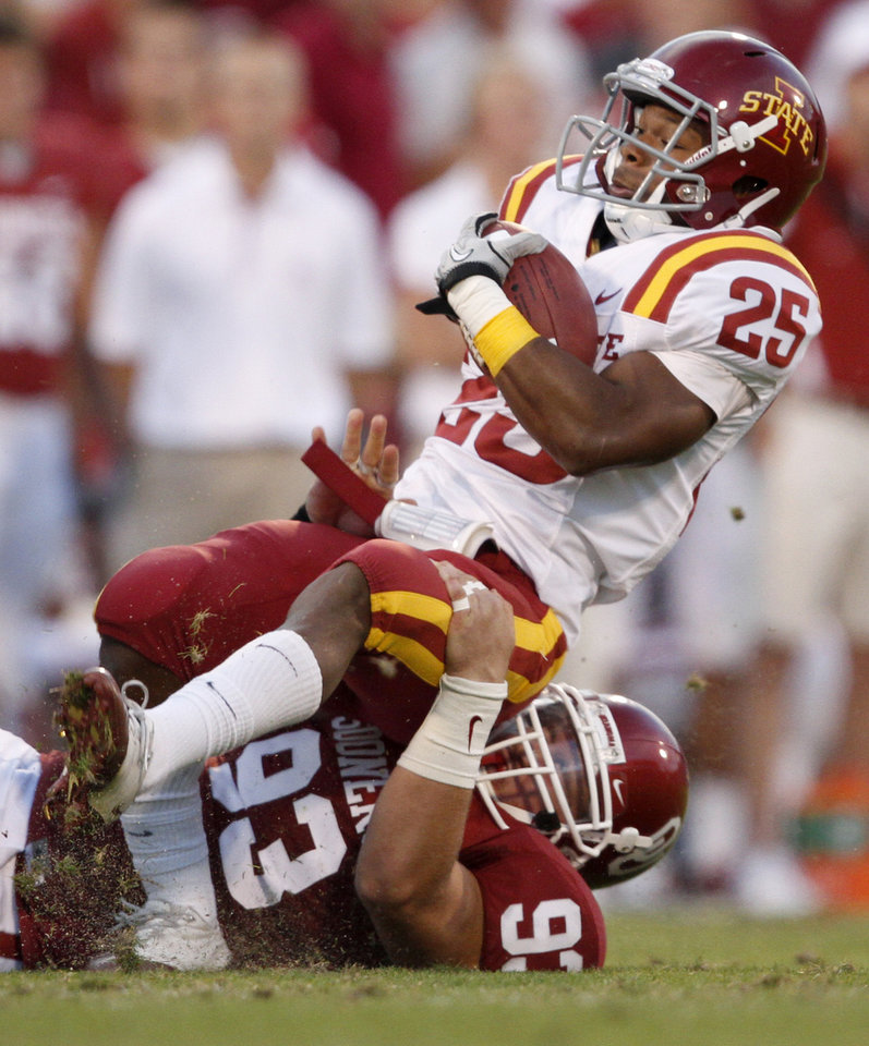 OU's Daniel Noble brings down Iowa State's Shontrelle Johnson during the first half of the college football game between the University of Oklahoma Sooners (OU) and the Iowa State Cyclones (ISU) at the Glaylord Family-Oklahoma Memorial Stadium on Saturday, Oct. 16, 2010, in Norman, Okla.   Photo by Bryan Terry, The Oklahoman