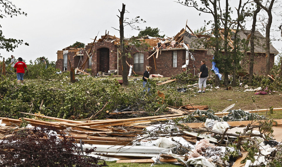 Photo - Volunteers help with the clean up of debris on Monday, May 10, 2010, in Oklahoma City, Okla. left behind by the tornados that hit central oklahoma on Monday. Photo by Chris Landsberger, The Oklahoman