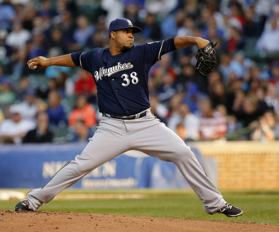 Photo - Milwaukee Brewers starting pitcher Wily Peralta delivers during the first inning of a baseball game against the Chicago Cubs Tuesday, Aug. 12, 2014, in Chicago. (AP Photo/Charles Rex Arbogast)