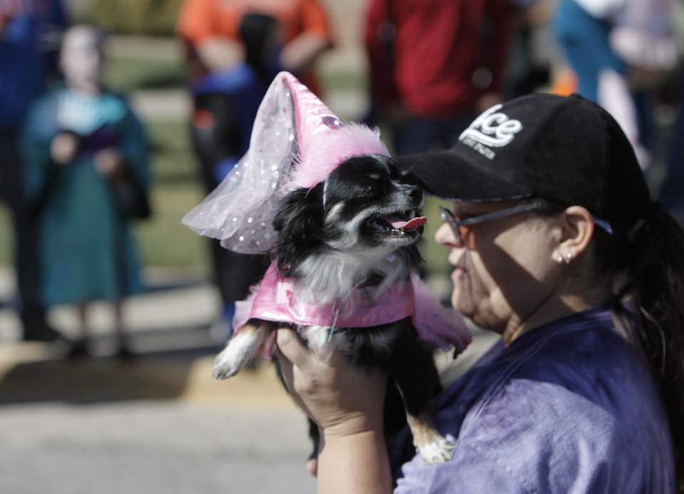 Sandra Boothe walks with her dog, Izabella, during a dog and child costume show at the Yukon Community Center in Yukon, Okla., Saturday, Oct. 27, 2012.  Photo by Garett Fisbeck, The Oklahoman