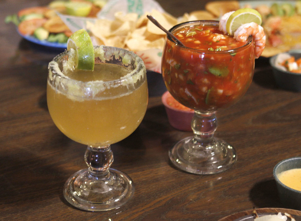 Few things say refreshment like a cold beer and shrimp cocktail at Chelino's in Oklahoma City.  Photo by Paul Hellstern, The Oklahoman <strong>PAUL HELLSTERN - Oklahoman</strong>