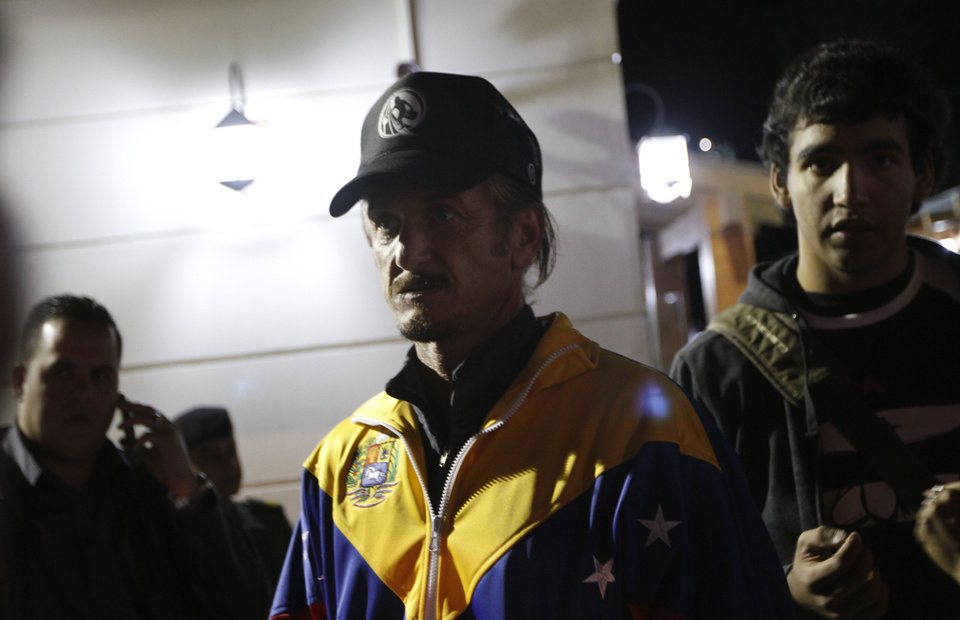 Photo - U.S. actor Sean Penn, center,  who is in Bolivia to attend the hearing of Jacob Ostreicher,  participates in a vigil for Venezuela's President Hugo Chavez in La Paz, Bolivia, Monday Dec. 10, 2012. Chavez's cancer relapse and his sudden announcement that he will undergo a fourth cancer-related surgery in Cuba have thrown Venezuela's future into question. Ostreicher is being held in a Bolivian prison in the eastern provincial capital of Santa Cruz while authorities investigate him for money laundering. (AP Photo/Juan Karita)