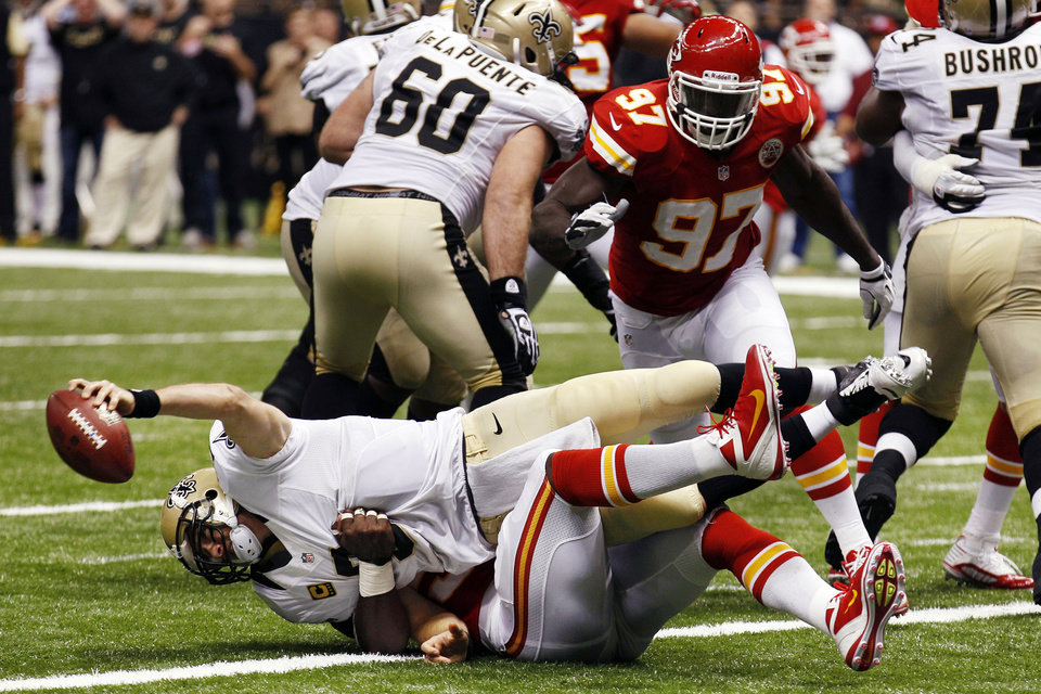Photo -   New Orleans Saints quarterback Drew Brees (9) is sacked for a safety in the second half of an NFL football game against the Kansas City Chiefs in New Orleans, Sunday, Sept. 23, 2012. (AP Photo/Bill Haber)