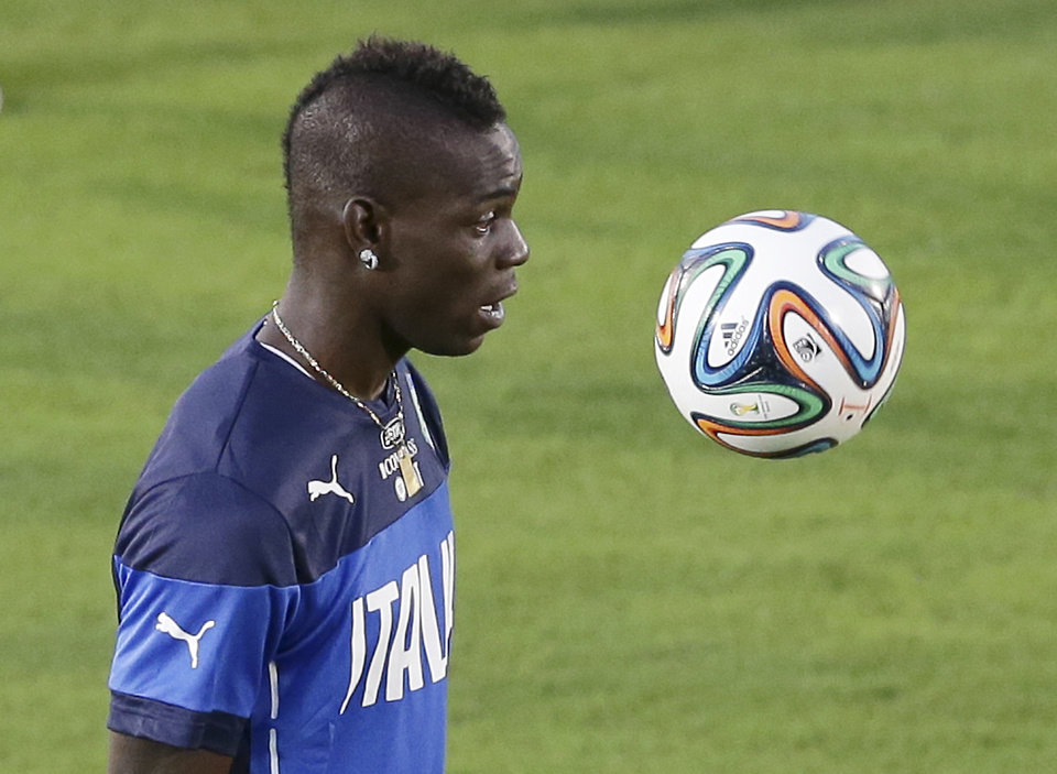 Photo - Italy's Mario Balotelli controls the ball during a training session of the Italian national soccer team in Natal, Brazil, Saturday, June 21, 2014. Italy proved ineffective in a 1-0 loss to Costa Rica on Friday and now the Azzurri need a win or a draw against Uruguay on Tuesday to reach the second round of the World Cup. (AP Photo/Antonio Calanni)
