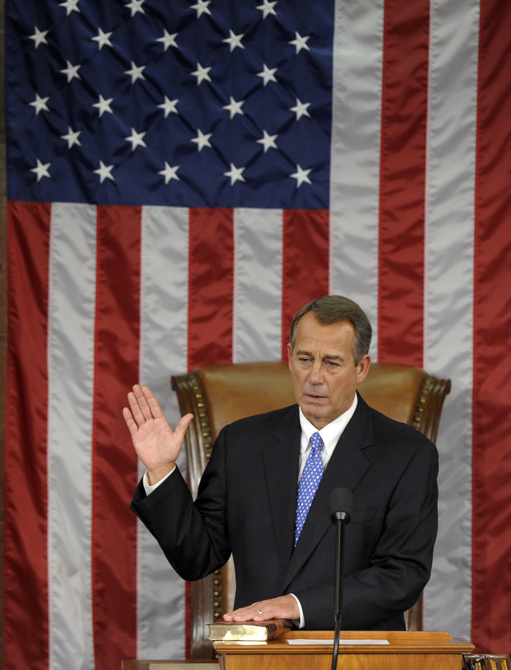 House Speaker John Boehner of Ohio is sworn in as the House Speaker of the 113th Congress, Thursday, Jan. 3, 2013, on Capitol Hill in Washington. (AP Photo/Susan Walsh)