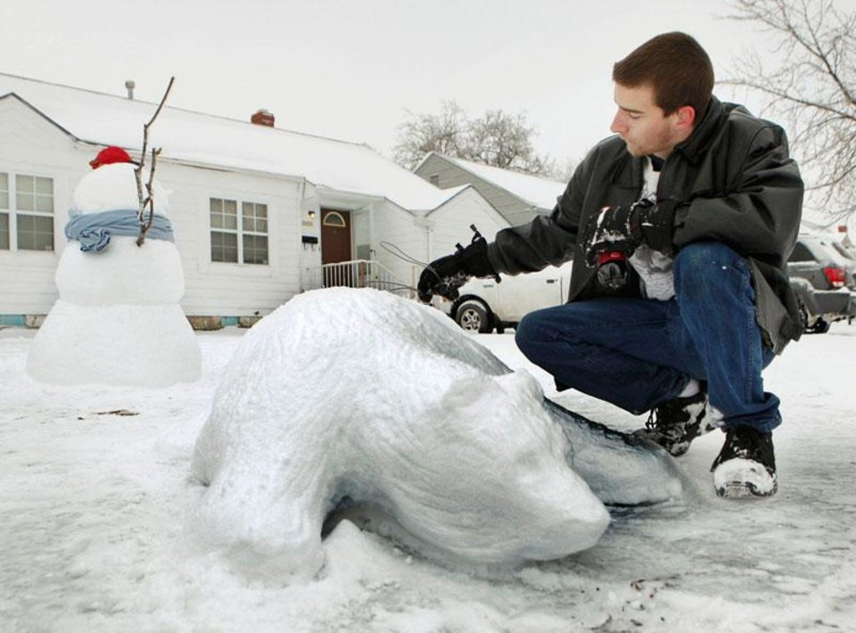 Oklahoma City resident Timothy Hickey puts the finishing touches on a polar bear at his home in Oklahoma City, Saturday, Jan. 30, 2010. By Paul Hellstern, The Oklahoman
