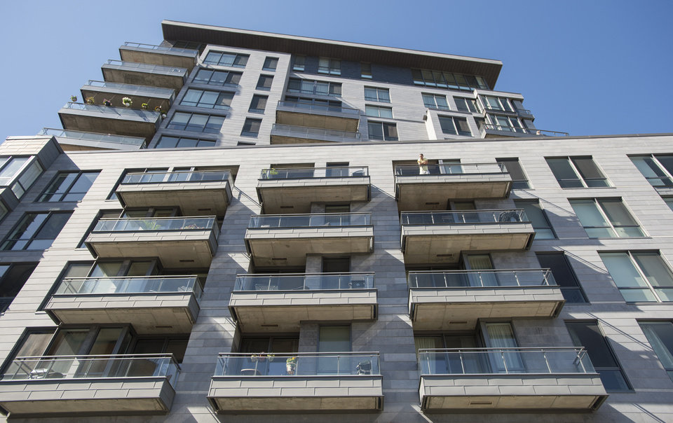 Photo - This photo shows an apartment building where three prison escapees were captured in Montreal, Sunday, June 22, 2014. The three men escaped from a Quebec City-area prison by helicopter on June 7. (AP Photo/The Canadian Press, Graham Hughes)