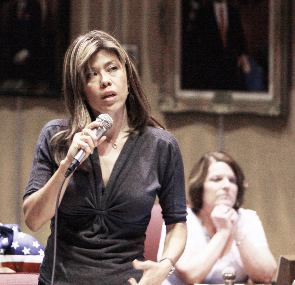 Photo - Arizona state Sen. Rebecca Rios, D-Apache Junction, front, talks about her vote against the immigration bill Monday  as Sen. Linda Lopez, D-Tucson, also a no vote, listens  in Phoenix. AP Photo