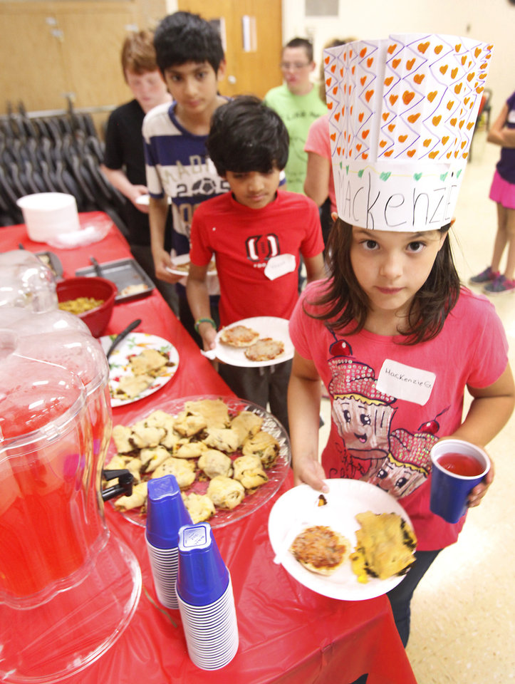 """Photo -  MacKenzie Goodwin, 9, gets some of the food she cooked in the """"Kids in the Kitchen"""" workshop. Photo by David McDaniel, The Oklahoman   David McDaniel -"""