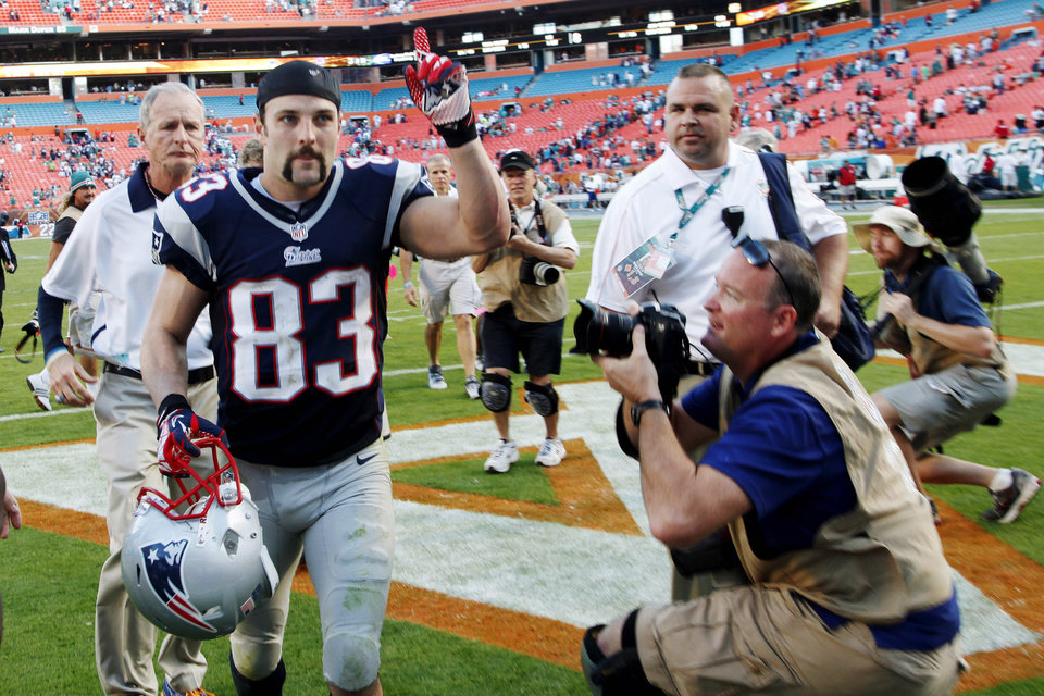 New England Patriots wide receiver Wes Welker (83) gestures to fans as he leaves the field after their 23-16 win in an NFL football game, Sunday, Dec. 2, 2012, in Miami. Welker tied Jerry Rice\'s NFL record by making at least 10 receptions for the 17th time. He had 12 catches for 103 yards and a score. (AP Photo/Wilfredo Lee)