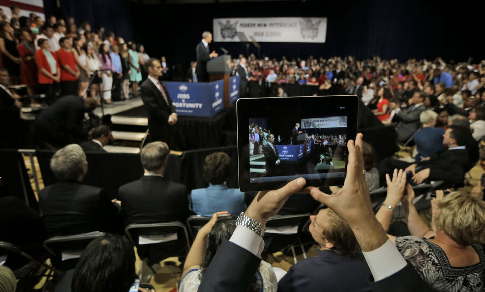 Photo - A members of the audience uses an iPad to record President Barack Obama speaking at Manor New Technology High School, Thursday, May 9, 2013 in Manor, Texas. (AP Photo/Pablo Martinez Monsivais)