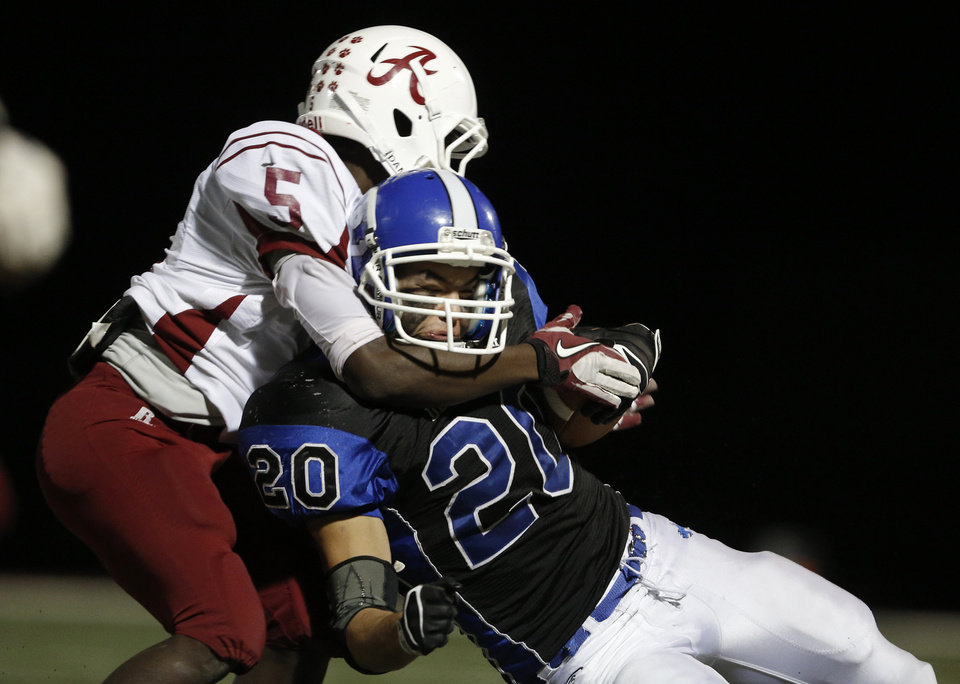 Deer Creek\'s Brennan Miyake (20) is taken down by Ardmore\'s Andrew Clark (5) during a high school football game between Deer Creek and Ardmore at Deer Creek Stadium in Edmond, Okla., Friday, Nov. 9, 2012. Photo by Garett Fisbeck, The Oklahoman