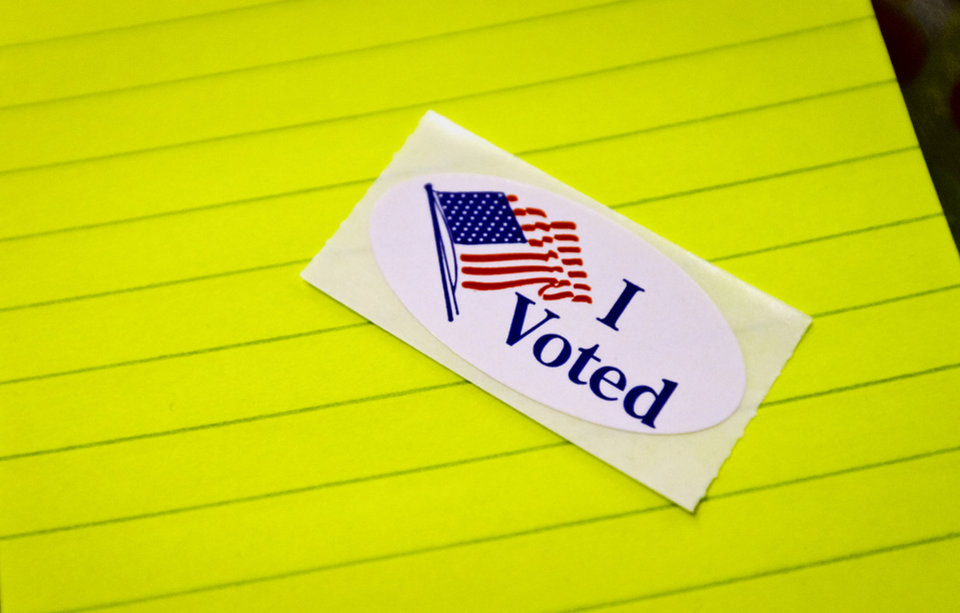 Photo - An 'I Voted' sticker sits on the table during election day on Tuesday, Nov. 6, 2012, in Yukon, Oklahoma. Photo by Chris Landsberger, The Oklahoman