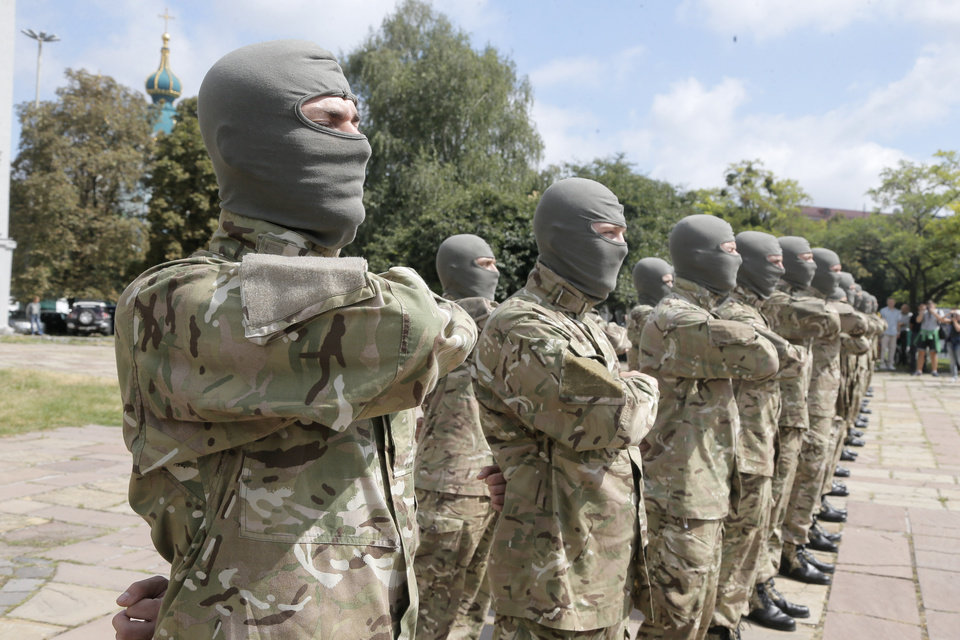 Photo - Volunteers take an oath of allegiance to Ukraine, before being sent to the eastern part of Ukraine to join the ranks of special battalion