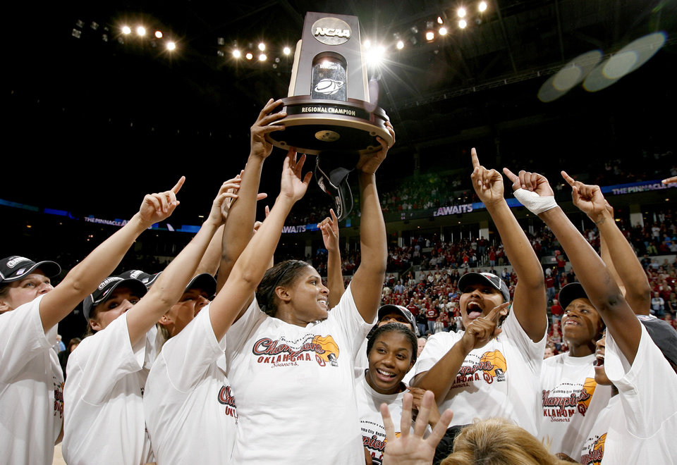 Photo - OU's Courtney Paris, center, celebrates after OU's win the NCAA women's basketball regional  tournament finals between Oklahoma and Purdue at the Ford Center in Oklahoma City, Tuesday, March 31, 2009. OU won, 74-68.  Photo by Bryan Terry, The Oklahoman