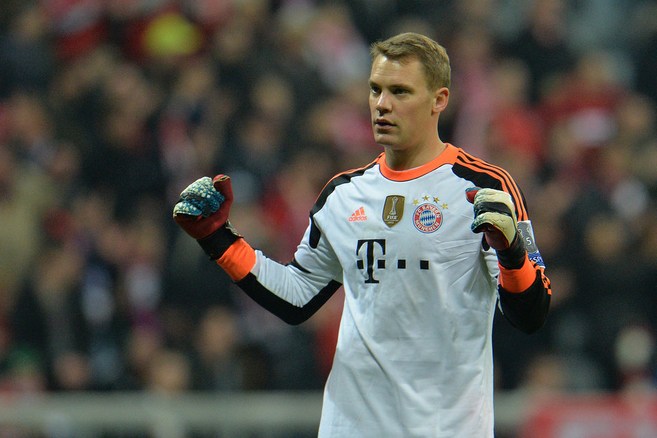 Photo - Bayern's goalkeeper Manuel Neuer celebrates after the Champions League round of the last 16 second leg soccer match between FC Bayern Munich and Arsenal FC in Munich, Germany, on Tuesday, March 11. 2014. The match finished 1:1. (AP Photo/Kerstin Joensson)