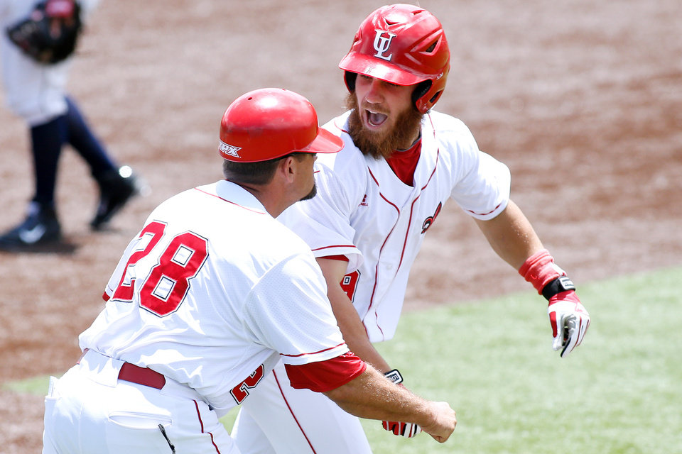 Photo - Louisiana-Lafayette's Jace Conrad, right, celebrates after hitting a grand slam in the second inning during an NCAA college baseball tournament regional game against Jackson State, Sunday, June 1, 2014, in Lafayette, La. (AP Photo/Jonathan Bachman)