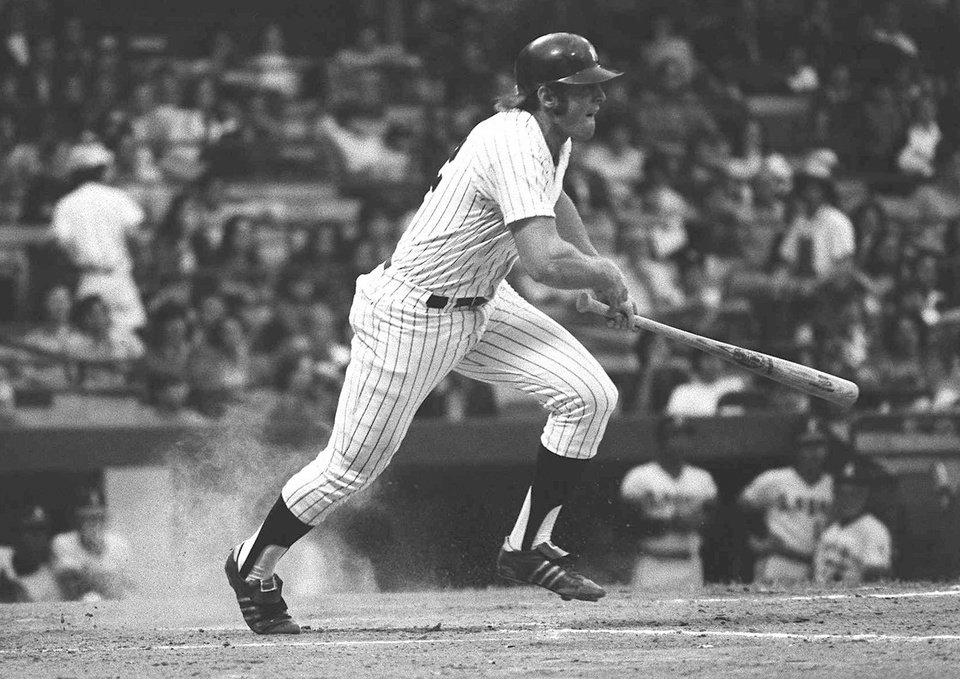 Photo - FILE - In this June 1, 1973, file photo, New York Yankees' Ron Blomberg heads for first after as he grounds out against the California Angels during a baseball game at Yankee Stadium in New York. Blomberg became the first major league designated hitter in an opening-day game in 1973.