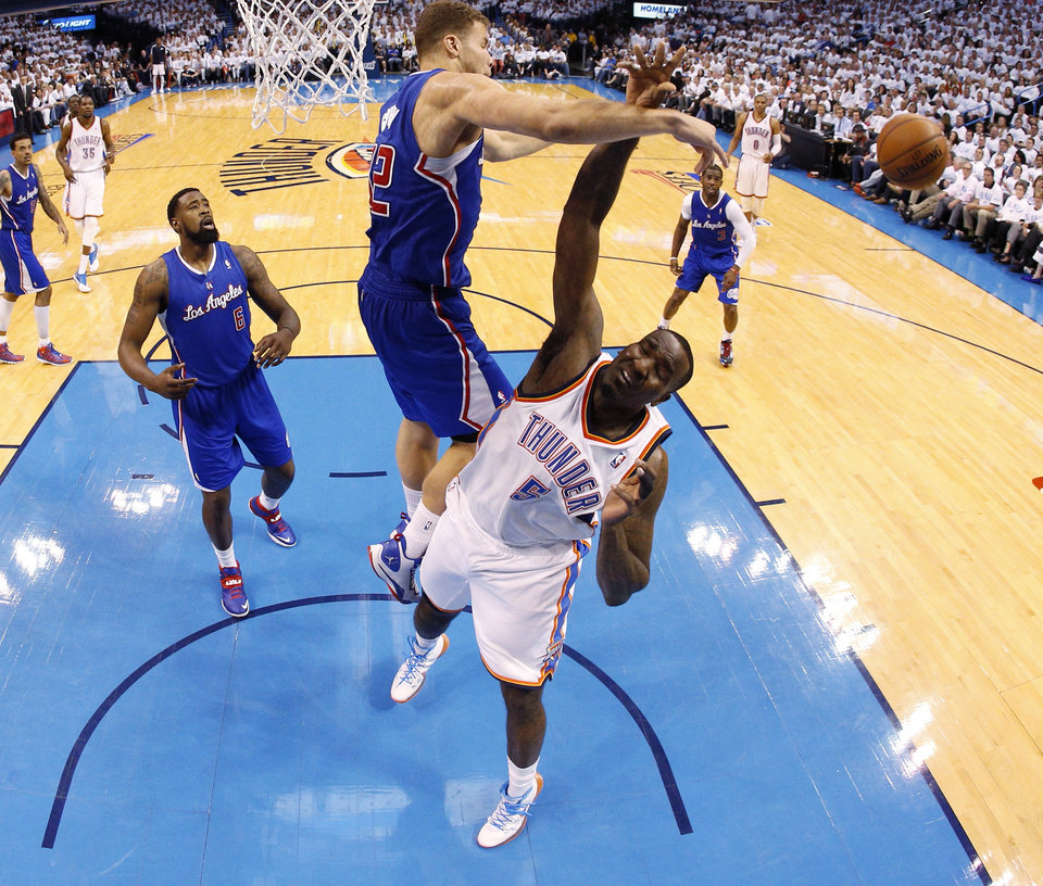 Photo - Los Angeles' Blake Griffin (32) blocks the shot of Oklahoma City's Kendrick Perkins (5) during Game 5 of the Western Conference semifinals in the NBA playoffs between the Oklahoma City Thunder and the Los Angeles Clippers at Chesapeake Energy Arena in Oklahoma City, Wednesday, May 14, 2014. Photo by Bryan Terry, The Oklahoman
