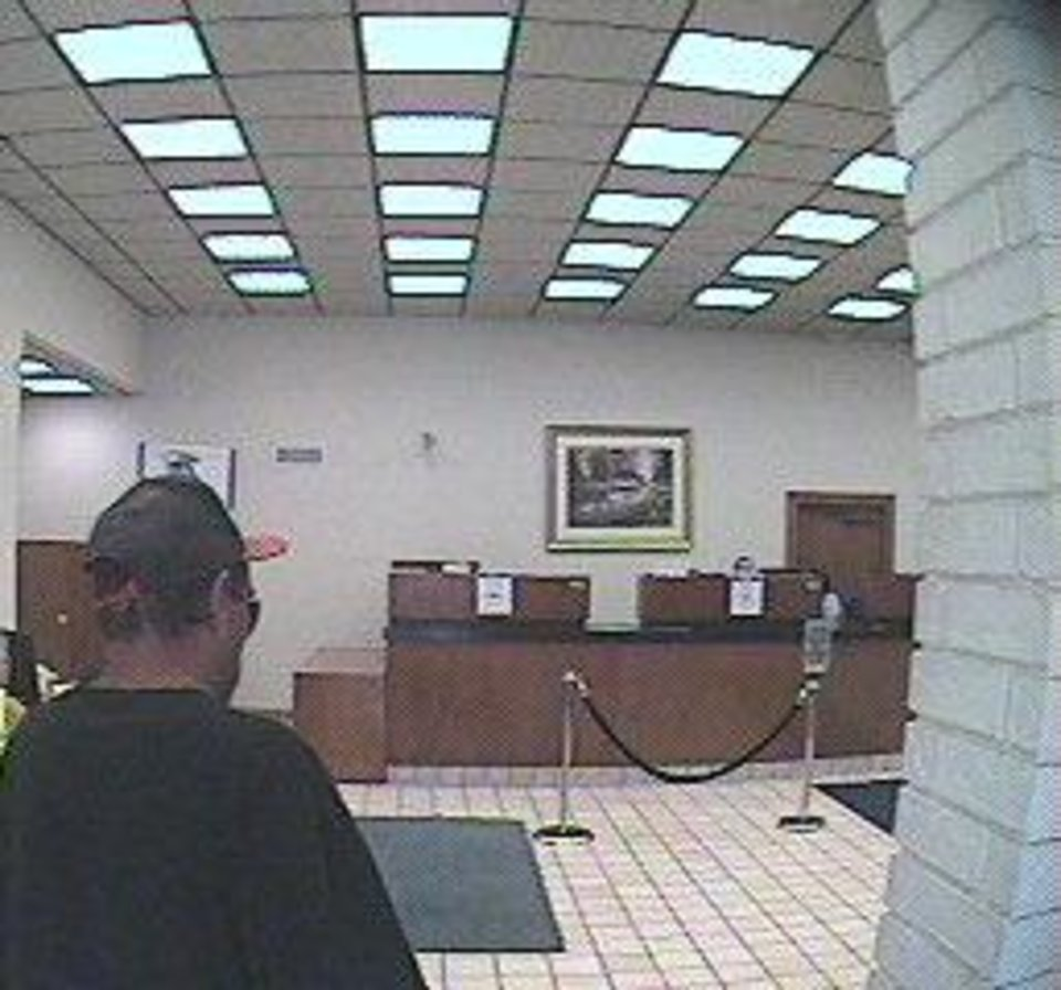 Surveillance photos of a man who robbed the First Fidelity Bank, 700 SW 29, on Tuesday afternoon. <strong></strong>