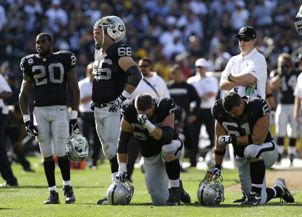 Photo -   Oakland Raiders from left, Darren McFadden, Cooper Carlisle, Mike Brisiel, and Stefen Wisniewski, wait on the field following the injury of wide receiver Darrius Heyward-Bey during the fourth quarter of an NFL football game against the Pittsburgh Steelers in Oakland, Calif., Sunday, Sept. 23, 2012. Oakland won 34-31. Heyward-Bey was taken to a hospital with a neck injury after a helmet-to-helmet hit from Steelers' Ryan Mundy that was not penalized. (AP Photo/Marcio Jose Sanchez)