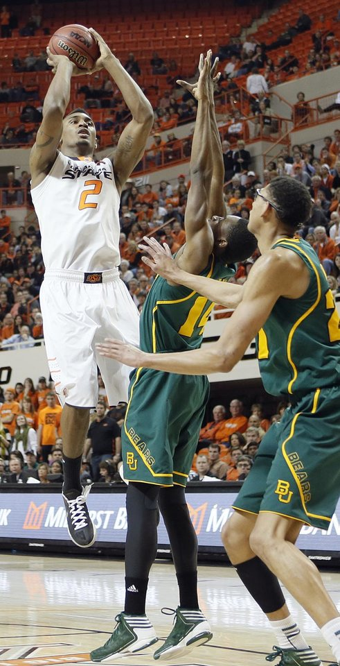 Oklahoma State 's Le'Bryan Nash (2) shoots the ball over Baylor's Deuce Bello (14) and Isaiah Austin (21) during the college basketball game between the Oklahoma State University Cowboys (OSU) and the Baylor University Bears (BU) at Gallagher-Iba Arena on Wednesday, Feb. 5, 2013, in Stillwater, Okla. Photo by Chris Landsberger, The Oklahoman
