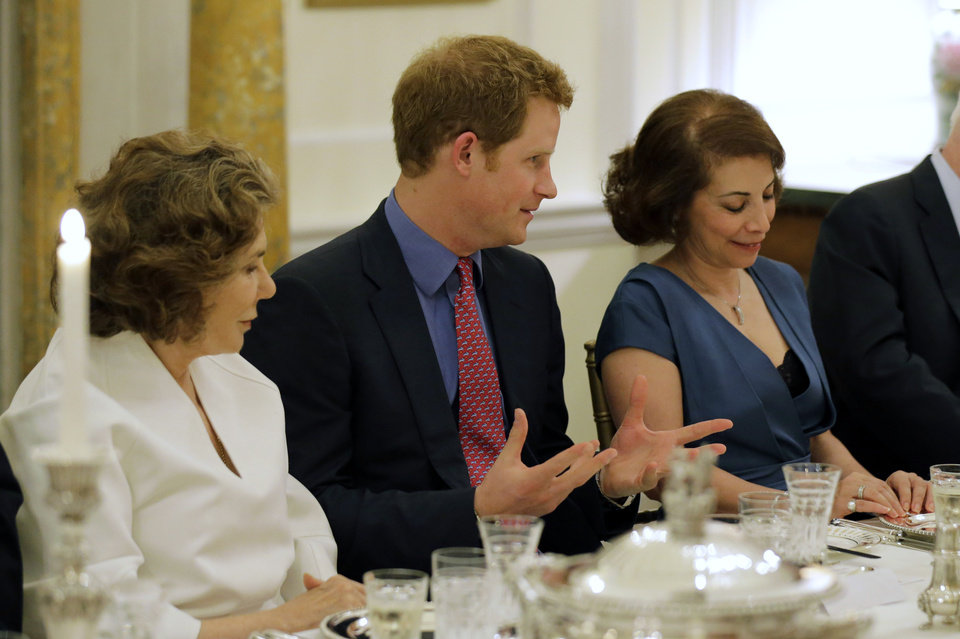 Photo - Teresa Heinz, left, sits with England's Prince Harry, and Lady  Westmacott, at a dinner at the British Ambassador's residence, Thursday, May 9, 2013 in Washington. (AP Photo/Alex Brandon, Pool)