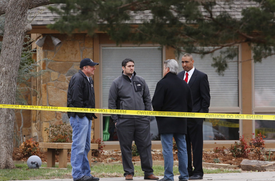 Pottawatomie County District Attorney Richard Smothermon,  second from right, talks to other members of his staff in the driveway of the crime scene. Shawnee police investigate the scene of a pre-dawn homicide in an upscale neighborhood in northeast Shawnee Thursday, March 21, 2013.  Police confirmed that Cathy Byus was killed in a domestic-related homicide inside her home at 27 Bella Vista Vista Lane.   Photo by Jim Beckel, The Oklahoman