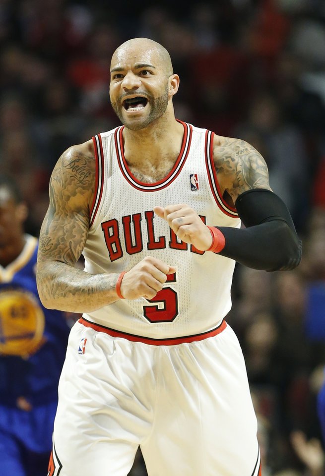Chicago Bulls forward Carlos Boozer reacts after scoring a basket during the first half of an NBA basketball game against the Golden State Warriors in Chicago on Friday, Jan. 25, 2013. (AP Photo/Nam Y. Huh)