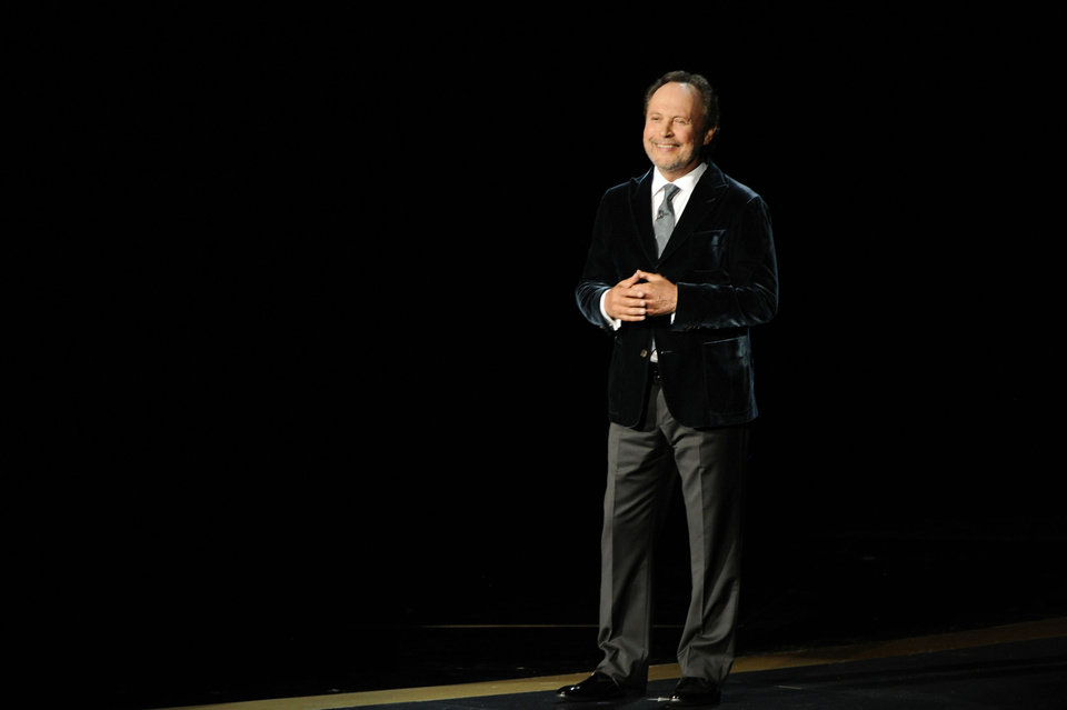 Photo - Billy Crystal speaks during an In Memoriam tribute to Robin Williams at the 66th Annual Primetime Emmy Awards at the Nokia Theatre L.A. Live on Monday, Aug. 25, 2014, in Los Angeles. (Photo by Chris Pizzello/Invision/AP)