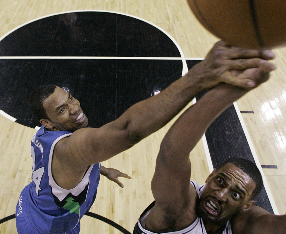 FILE - In a March 17, 2009, file photo Minnesota Timberwolves center Jason Collins, left, defends San Antonio Spurs center Kurt Thomas during the first quarter of an NBA basketball game in San Antonio. A person familiar with the situation says Jason Collins and the Brooklyn Nets are meeting in California and he could sign with the team on Sunday Feb. 23, 2014.   (AP Photo/Eric Gay, file)