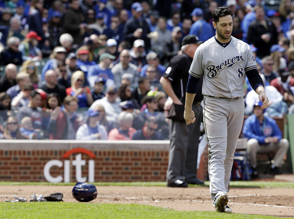 Photo - Milwaukee Brewers' Ryan Braun walks back to the dugout after striking out during the third inning of a baseball game against the Chicago Cubs in Chicago, Saturday, May 17, 2014. (AP Photo/Nam Y. Huh)