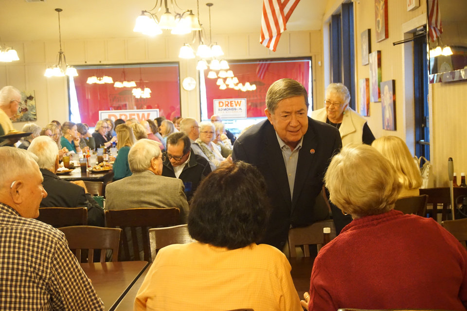 Photo -  Gubernatorial candidate Drew Edmondson meets supporters at a restaurant in McAlester during a campaign tour on Thursday. [Photo by Ben Felder, The Oklahoman]