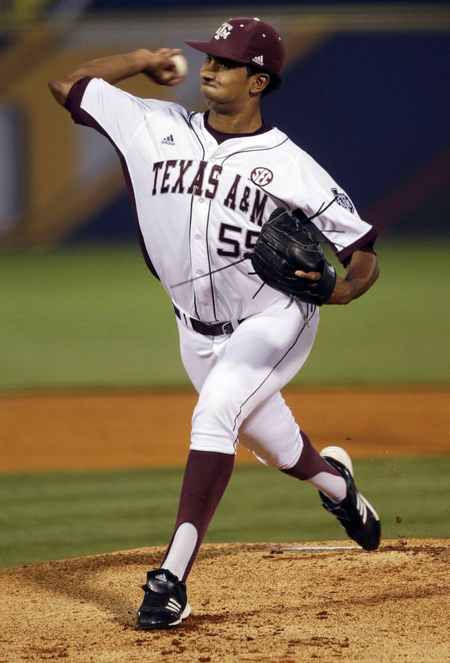 Photo - Texas A&M's Rafael Pineda pitches in the first inning of their Southeastern Conference Tournament NCAA college baseball game against Mississippi State at the Hoover Met in Hoover, Ala., Thursday, May 23, 2013. (AP Photo/Dave Martin)