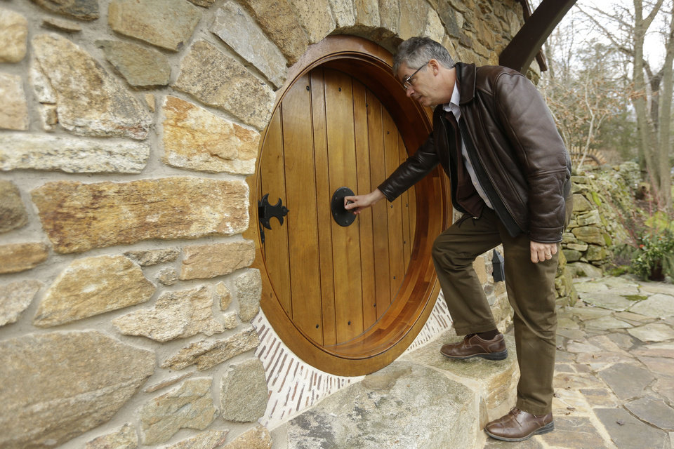 "Architect Peter Archer enters the ""Hobbit House"" during an interview with the Associated Press Tuesday, Dec. 11, 2012, in Chester County, near Philadelphia.  Archer has designed a ""Hobbit House"" containing a world-class collection of J.R.R. Tolkien manuscripts and memorabilia. AP Photo"