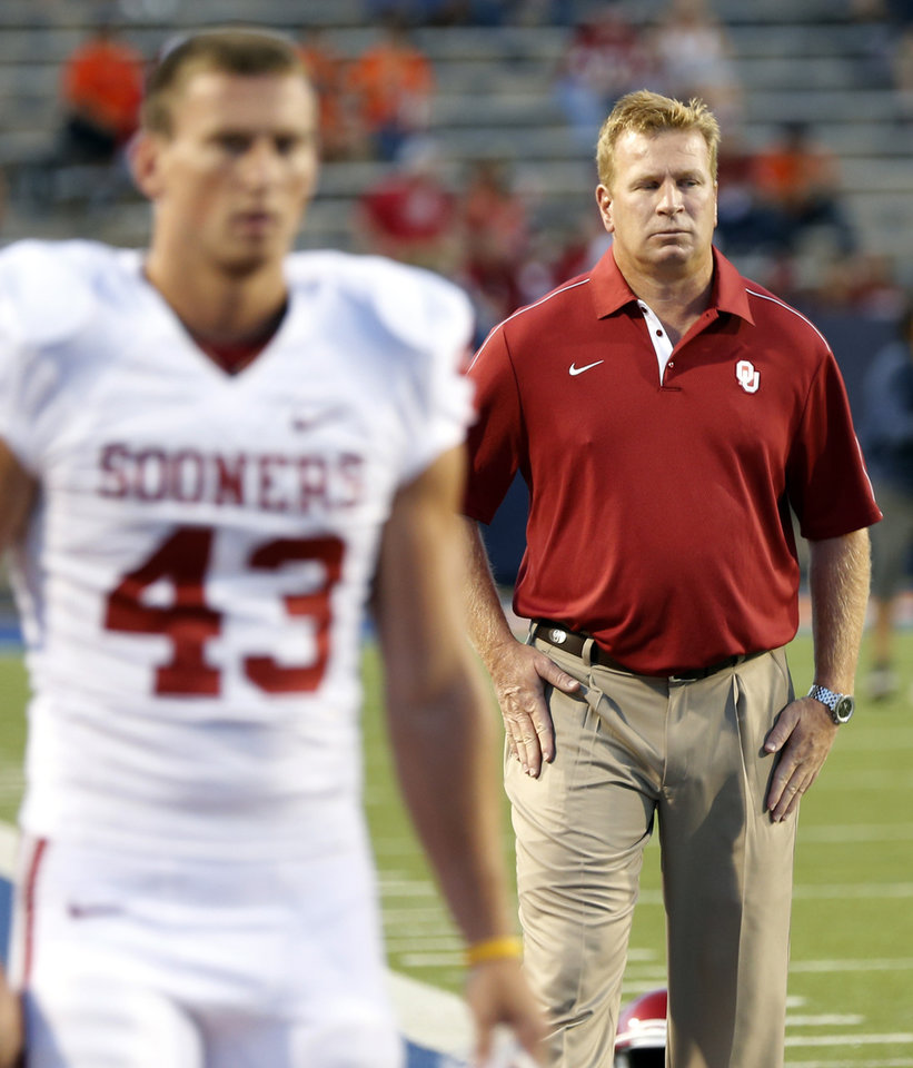 Photo - Mike Stoops walks the field with Patrick O'Hara (43) during the college football game between the University of Oklahoma Sooners (OU) and the University of Texas El Paso Miners (UTEP) at Sun Bowl Stadium on Saturday, Sept. 1, 2012, in El Paso, Tex.  Photo by Chris Landsberger, The Oklahoman