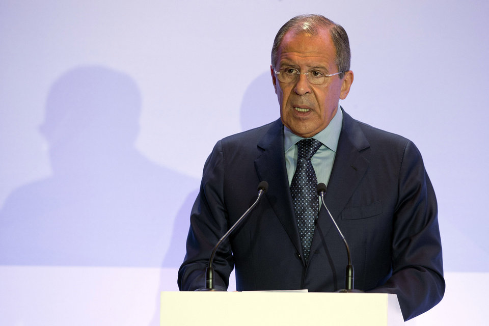 Photo - Russian Foreign Minister Sergey Lavrov addresses a security conference in Moscow, Russia on Friday, May 23, 2014. Lavrov on Friday urged the West to stop playing what he described as a zero-sum game against Russia and reach a settlement based on mutual interests.  (AP Photo/Pavel Golovkin)