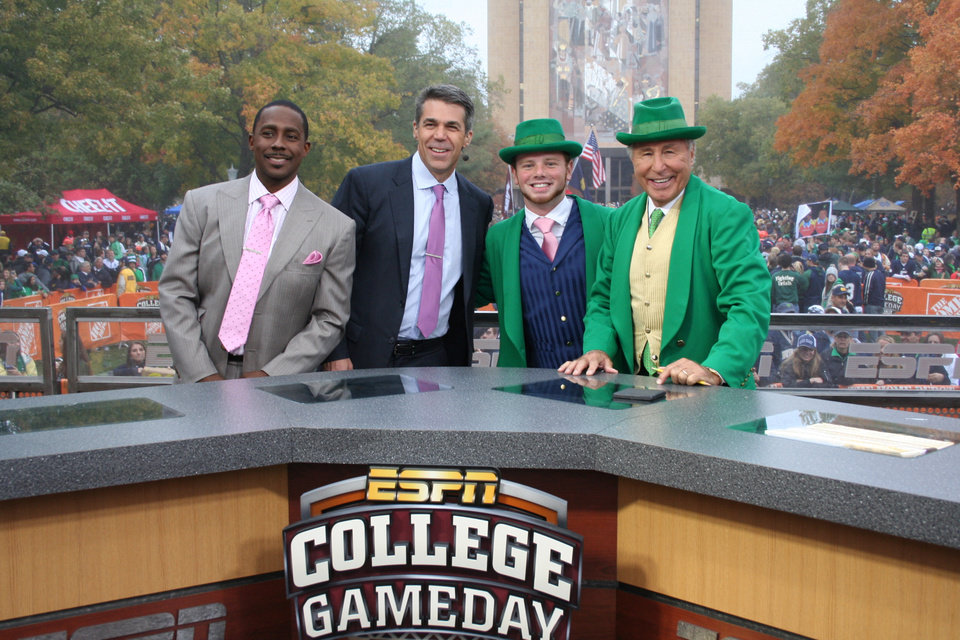ESPN\'s College GameDay Crew Desmond Howard and Chris Fowler with the Notre Dame Leprechaun and Lee Corso dressed up like the Leprechaun. (Photo courtesy of Tammie Burton)