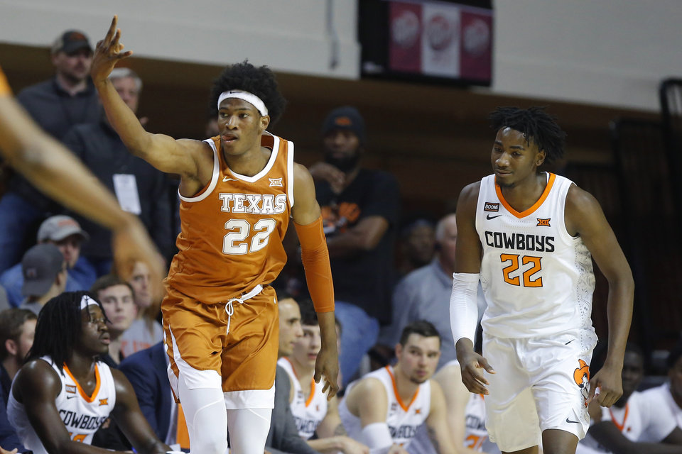 Photo - Texas' Kai Jones (22) celebrates after a basket beside Oklahoma State's Kalib Boone (22) during an NCAA basketball game between the Oklahoma State University Cowboys (OSU) and the Texas Longhorns at Gallagher-Iba Arena in Stillwater, Okla., Wednesday, Jan. 15, 2020. [Bryan Terry/The Oklahoman]
