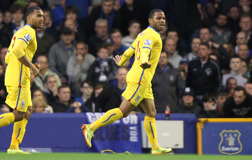 Photo - Crystal Palace's Jason Puncheon, right, celebrates scoring their first goal of the game against Everton during their English  Premier League match at Goodison Park, Liverpool, England  Wednesday April 16, 2014. (AP Photo/Barry Coombs/PA) UNITED KINGDOM OUT