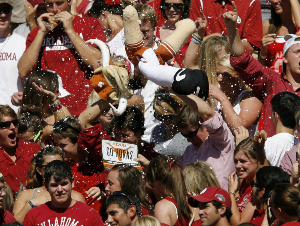 OU fans rip open a Bevo doll during the first half of the Red River Rivalry college football game between the University of Oklahoma Sooners (OU) and the University of Texas Longhorns (UT) at the Cotton Bowl on Saturday, Oct. 2, 2010, in Dallas, Texas.   Photo by Bryan Terry, The Oklahoman