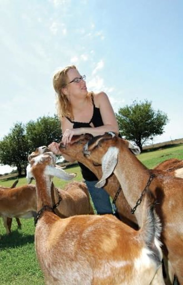 In this Wednesday Aug. 19, 2009 photo,  Shelley  Larsen interacts with some of the goats of Last Laugh Farms, a local goat milk producer in Enid, Okla.  Larsen owns Last Laugh Farms with her mother, Belinda Jung. (AP Photo/Enid News & Eagle, Bridget Nash)