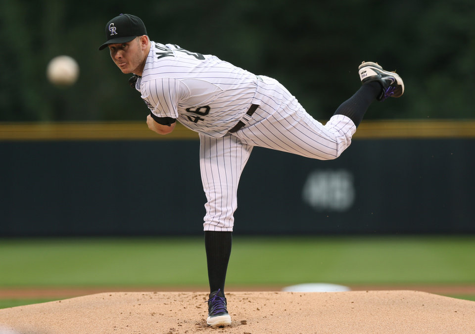 Photo - Colorado Rockies starting pitcher Tyler Matzek watches a delivery against the Pittsburgh Pirates in the first inning of a baseball game in Denver on Saturday, July 26, 2014. (AP Photo/David Zalubowski)