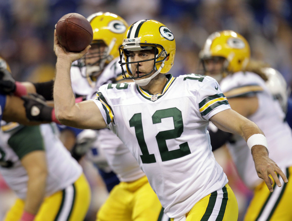 Photo -   Green Bay Packers quarterback Aaron Rodgers passes during the first half of an NFL football game against the Indianapolis Colts in Indianapolis, Sunday, Oct. 7, 2012. (AP Photo/Michael Conroy)