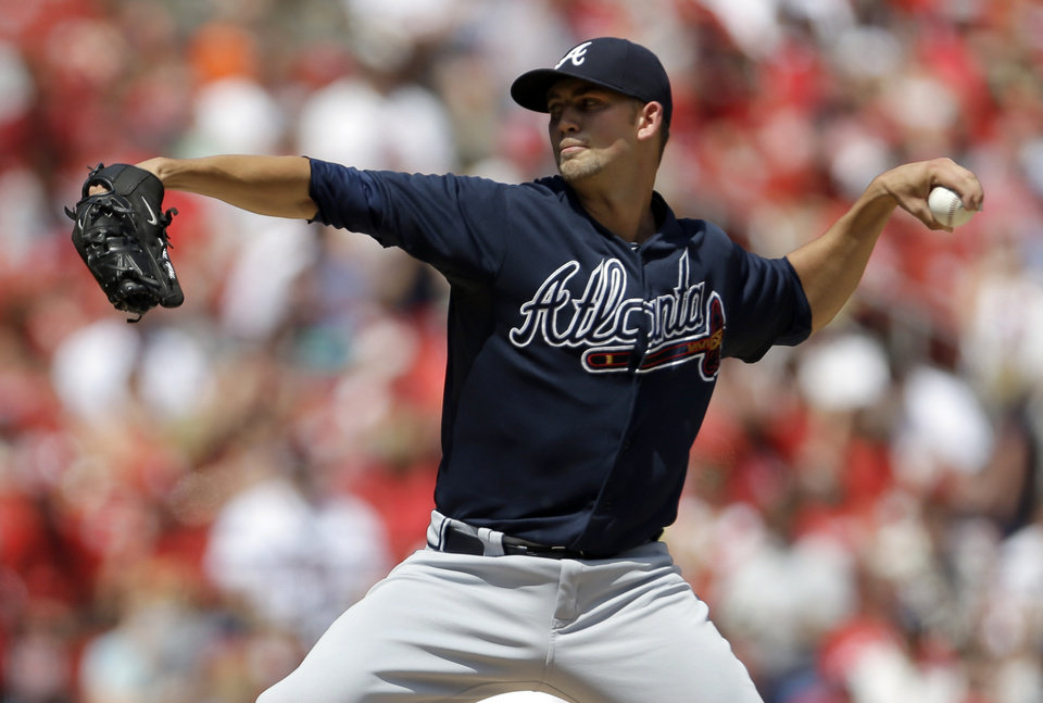 Photo - Atlanta Braves starting pitcher Mike Minor throws during the first inning of a baseball game against the St. Louis Cardinals, Sunday, Aug. 25, 2013, in St. Louis. (AP Photo/Jeff Roberson)